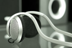 Audio head-phones with speakers at the background Royalty Free Stock Photography
