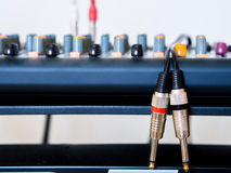 Audio jack cable and mixer. Stock Image