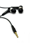 Audio jack and earphone. On white (the focus is on the jack Royalty Free Stock Images
