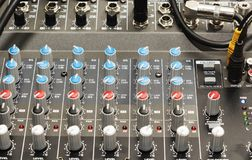 Audio jack and wires connected to audio mixer, music dj equipment at concert, festival, bar. Audio jack and wires connected to audio mixer, music dj equipment royalty free stock image