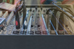 Audio jacks and wires connected to audio mixer Royalty Free Stock Photos