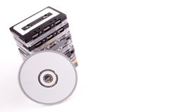 Audio K7 to white CD Stock Image