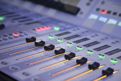 Audio level sliders on sound mixer. Cold picture of audio level sliders on an electric sound mixer royalty free stock photos