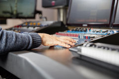 Audio mastering on a professional mixer stock photography