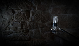 Audio microphone. Old audio microphone in a stone studio recording Stock Photography