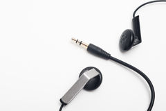 Audio mini-jack and earphones Stock Images