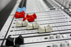 Audio mixer. Faders on a audio mixer. Mixers are used to adjust sounds from the main speakers Stock Photo