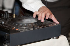 Audio mixer. A man working on a audio mixer Stock Photography