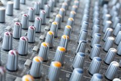 Audio mixer. With colored knobs stock photos