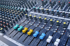 Audio-mixer. With blue and yellow and white buttons Royalty Free Stock Images