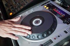 Audio mixer. A man working on a audio mixer Stock Image
