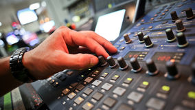 Audio mixer. Mixing board fader and knobs stock images