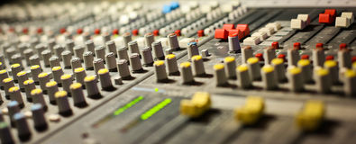 Audio mixer. Mixing board fader and knobs stock image