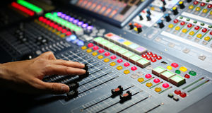 Audio mixer. Mixing board fader and knobs stock photography