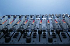 Audio mixer on blue background. Technology in music. With copy space stock photos
