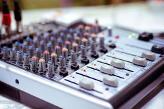 Audio Mixer. Board on a desk royalty free stock image
