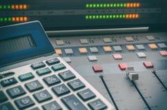Audio mixer and calculator. In radio studios Royalty Free Stock Photos