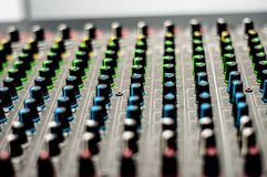 Audio mixer console. With colorful knobs stock photo
