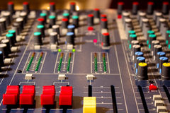 Audio mixer. Control panel on the audio mixer with knob and slide potentiometers,photography royalty free stock photo