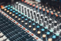 Audio mixer control panel or sound editor, cinematic tone. Digital music technology, concert event, DJ equipment concept. Buttons and knob switches of audio royalty free stock images
