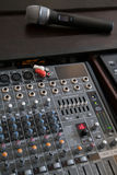 Audio mixer deck with microphone Stock Photo