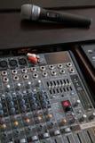 Audio mixer deck with microphone Stock Photo