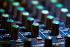 Audio mixer detail. Audio mixers are an intimidating equipment for most of the people. It is filled with lots of turning potentiometer, slide potentiometers and Stock Image