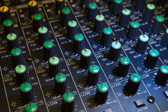 Audio mixer detail. Audio mixers are an intimidating equipment for most of the people. It is filled with lots of turning potentiometer, slide potentiometers and Royalty Free Stock Image