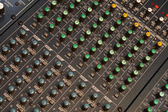 Audio mixer detail. Audio mixers are an intimidating equipment for most of the people. It is filled with lots of turning potentiometer, slide potentiometers and Stock Photo
