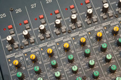 Audio mixer detail. Audio mixers are an intimidating equipment for most of the people. It is filled with lots of turning potentiometer, slide potentiometers and Stock Photos