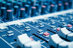 Audio mixer detail. Audio mixer with shallow depth of field - blue toned stock image