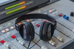 Audio mixer and headphones. In radio studio Royalty Free Stock Photography