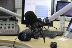 Audio mixer knobs during live TV telecast. Professional audio operator working on audio mixer knobs during live TV telecast stock photography