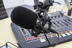 Audio mixer knobs during live TV telecast. Professional audio operator working on audio mixer knobs during live TV telecast stock photos