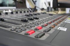 Audio mixer knobs during live TV telecast. Professional audio operator working on audio mixer knobs during live TV telecast royalty free stock photo