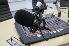 Audio mixer knobs during live TV telecast. Professional audio operator working on audio mixer knobs during live TV telecast stock images