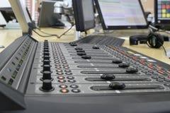 Audio mixer knobs during live TV telecast. Professional audio operator working on audio mixer knobs during live TV telecast royalty free stock photography