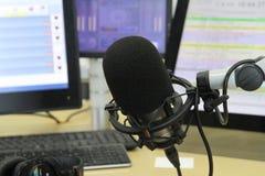 Audio mixer knobs during live TV telecast. Professional audio operator working on audio mixer knobs during live TV telecast royalty free stock images