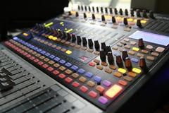 Audio mixer knobs during live TV telecast. Professional audio operator working on audio mixer knobs during live TV telecast royalty free stock image