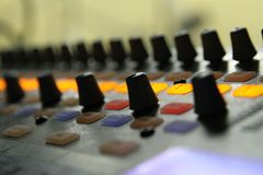 Audio mixer knobs during live TV telecast Royalty Free Stock Photography
