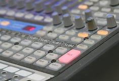 Audio mixer knobs during live TV telecast. Professional audio operator working on audio mixer knobs during live TV telecast royalty free stock photos