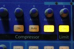 Audio mixer knobs during live TV telecast. Professional audio operator working on audio mixer knobs during live TV telecast stock image