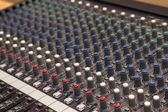 Audio mixer. Audio mixing console in a recording studio. Faders and knobs of a sound mixer royalty free stock image