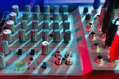 Audio mixer music desk under colorful lights Royalty Free Stock Images