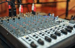 Audio mixer, music equipment. recording studio gears, broadcasting tools, mixer, synthesizer. shallow dept of field for music. Background Stock Images