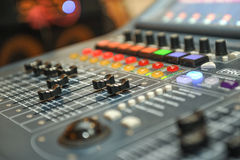 Audio mixer, music equipment. recording studio gears, broadcasting tools, mixer, synthesizer. shallow dept of field for music. Background Royalty Free Stock Photography