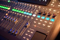 Audio mixer in a recording studio. Hand adjusting sound mixer Stock Image
