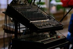 Audio mixer with slide and knobs bars that are used to adjust sound stock image