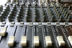 Audio mixing console. Knobs and controls on modern audio mixing console Stock Photo