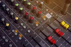 Audio mixing console knobs. Slide Red Control System audio mixer.  royalty free stock photo
